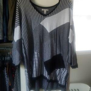 Black/white sweater tunic, bangle watch